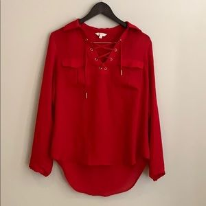 Red chiffon blouse with cross top.